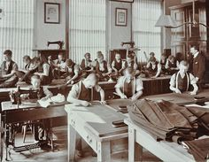 Boys' tailoring class at Highbury Truant School Islington London 1908 Boys learn to make clothes some draw patterns others use sewing machines while...