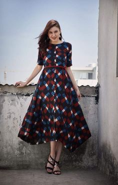 Shop online Criss Cross Midi The cotton criss cross dress with a boat neck, stylized c-hem and the belt addition is sure to up your style quotient. Pair it with statement earrings and block heels to have that perfect look. Simple Frocks, Casual Frocks, Frock Models, Mehendi Outfits, Indian Gowns, Pakistani Dress Design, Western Dresses, Dress For Short Women, Dress Patterns