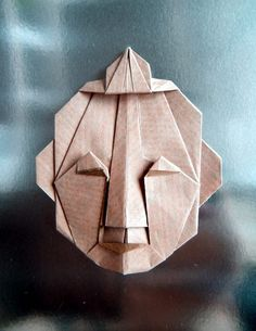 "From a bicolored square Diagram: in BOS Magazine 100 and in the book ""Folding Faces"" by Eric Kenneway"