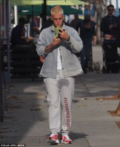Splashed some cash: The Sorry star's wet patch covered his entire crotch area and was rather visible in his almost $700 grey Vetements sweatpants