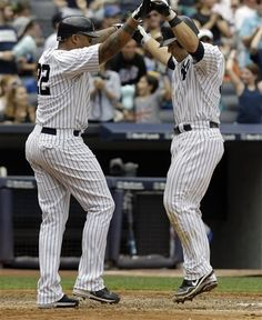GAME 59: Sunday, June 10, 2012 - New York Yankees' Andruw Jones, left, celebrates with teammate Russell Martin at the plate after Martin's seventh-inning two-run home run during their baseball game against the New York Mets at Yankee Stadium in New York. (AP Photo/Kathy Willens)