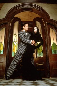 "Anjelica Huston (July 1951 - ) as Morticia Addams and Raul Julia (March 1940 - October as Gomez Addams ""The Addams Family"", 1991 Colin Morgan, The Addams Family, Adams Family Morticia, Halloween Movies, Halloween Kostüm, Halloween Costumes, Halloween Couples, Halloween Tricks, Halloween Decorations"