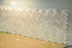 herringbone marble backsplash