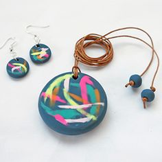 Make this gorgeous painterly pendant and matching earrings with polymer clay. Brilliant step-by-step tutorial with full photography.