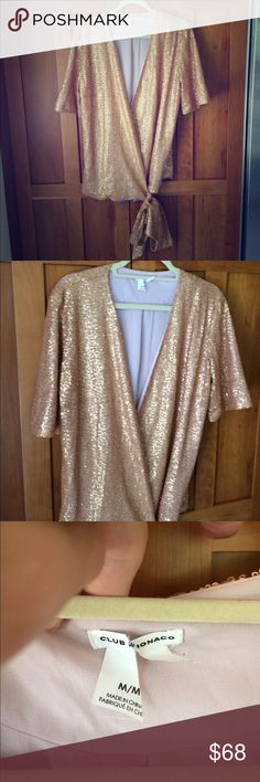 Club Monaco sequin kimono wrap top This is gorgeous, pics don't do it justice. To be honest, I can't figure out if this is meant to be a top or more of a wrap jacket. Likely a top but if can be worn as both. Covered in rose gold sequins all over, kimono style. Adjustable wrap. The front neckline is very open and plunging, therefore if you wore as a top you'd likely want a cami under it (or not). Fabric content tag was removed. The main tag is cut as shown. Worn twice in amazing condition…