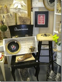 Mementos designs...Keep Calm and Carry On framed print, custom vinyl on chair, and vintage sheet music on tray...among other fancy things!