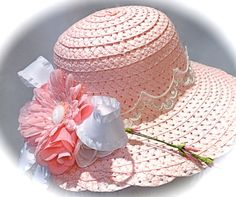 This dainty pink girls tea party hat or Easter bonnet has a bouquet of silk flowers including a cute pink polka dot daisy and white & pink roses.