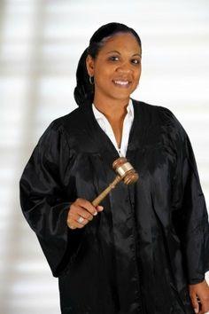 Judge Marsha Baker loves her job. See, she's smiling!