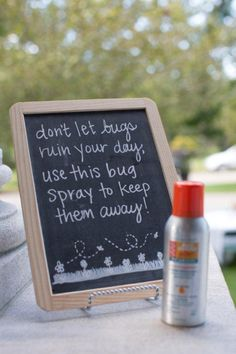 Chalkboard signs for bug spray at a wedding. Don't let bugs ruin your guests time