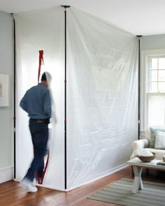 "When renovating, Martha suggests using plastic sheeting, spring-loaded poles, and an adhesive zipper, to create a ""mudroom"" and lock in dust."