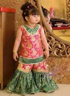 Girls Sharara Dress Designs 2019 For Wedding Green and pink jamawar baby girls sharara dress designs 2018 for wedding partyGreen and pink jamawar baby girls sharara dress designs 2018 for wedding party Wedding Dresses For Kids, Dresses Kids Girl, Kids Outfits, Flower Girl Dresses, Baby Dresses, Dress Girl, Baby Outfits, Sharara Designs, Choli Designs