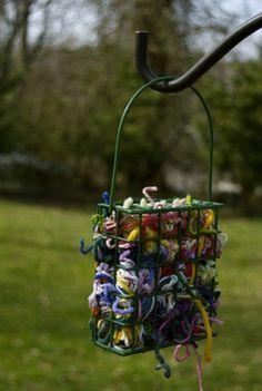 This is supposed to be a homemade basket, but looks like a cheap suet holder used for bird nest  supplies. :)
