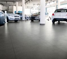 Our anthracite-coloured tiles are perfect for this car dealership showroom.