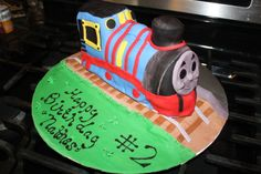 This Chugga Choo was made for Daniel's 2nd. birthday and did travel well. The cake drooped a little by the time I drove 3 hours in the car. The kids loved it anyway and didn't seem to notice.