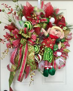 This unique Wreath measures 28 inches diagonally from tip to tip. Designed with mesh, ribbons, and all the trimmings! All our wreaths listed are