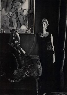 Marella Agnelli, wearing an emerald velvet dress by Dior, in front of a Picasso and an 18th c. sculpture of a monkey. Photo by Henry Clarke. Vogue, August 1962.