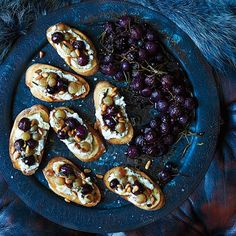 Ricotta and Roasted Grape Crostini   Roasting the grapes concentrates and deepens their sweetness.