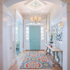 Make an entrance. Kate Spain's Alhambra rug greets guests in this beautiful foyer. (ALH-5007)