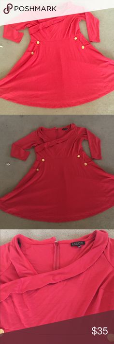 Cross Front Dress This dress has so much style to it. 4 gold colored buttons. Has pockets. Take a walk back on time with class. Woman's size 18. In good condition. Thanks for looking and feel free to ask me any questions 😀 Eloquii Dresses