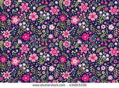 Cute pattern in small flower. Small pink flowers. Dark blue background. Ditsy floral background. The elegant the template for fashion prints.
