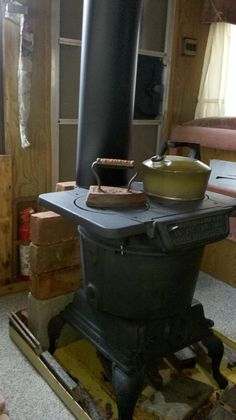 I installed my antique wood stove in the off grid living camper. Free heat, hot water and cooking.
