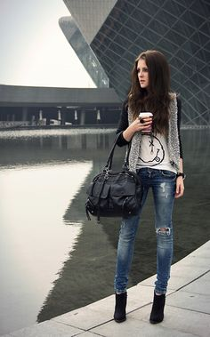 white graphic tee, gray vest, black long sleeves, distressed denims and black booties #casual