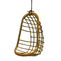 """Rattan"" Hanging Chair, Retail Price: $$544 Housing Works Price: $270 Donated by Two's Company, Featured in a room by George Oliphant"