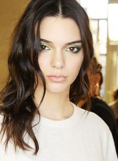 Kendall Jenner knows that green eyeshadow makes brown eyes look extra bright