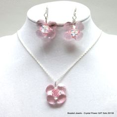 Charming Vintage Rose Swarovski Crystal Flower Necklace and Earrings Set  N_Set_677_ROCR  Charming and feminine is this handmade sterling silver 1.3mm  rope chained necklace/earrings set with a bead-woven 7/8 inch flower pendant out of four vintage rose flat briolette swarovski crystal petals ea 10x11mm. The eight rose AB and dark aqua AB/Crystals  ea 4mm. complete the crystal flower pendant and add even more sparkle to it's appearance.   This set will make a nice addition to your jewelry…