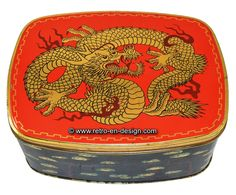 Vintage tin by Cote d'Or with Chinese dragon Lovely tin by Cote d'Or for chocolate. This tin has a hinged lid and has an image of a golden Chinese dragon against a red background. The lid has a wide golden rim. On the sides of this tin are several images of a Chines Elm shaped as a Bonsai tree against a black background.  http://www.retro-en-design.co.uk/a-46965568/tins/vintage-tin-by-cote-d-or-with-chinese-dragon/