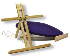 Adjustable pillow stand holds your lacing pillow at any angle for ease of use. An old table top easel could work too.