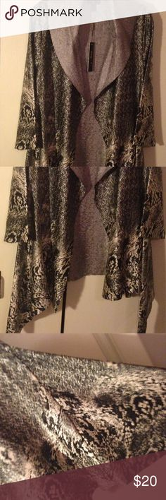 Jerry T New York open dress jacket Wrap style jacket with asymmetrical hem. Animal like print in shades of black, gray and silver. Dramatic color in silver textured fabric that matches jacket lining. Bell sleeves. NWT. Jerry T New York Jackets & Coats