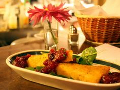 Crispy polenta with a red wine cranberry sauce at The Canebrake Restaurant & Resort.