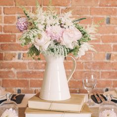 Cream metal jugs (shabby chic) wedding table decorations.  Available from www.theweddingofmydreams.co.uk @The Wedding of my Dreams #wedding #centrepiece #vase