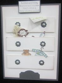 Simple (except for cutting out all the little items! ), cute baby dresser card.