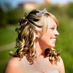 Half Updo Wedding Hairstyles Tiara | With her hair drawn back, this bride allowed most of her hair to fall ...