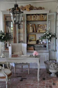 Curvy leg writing desk, French look, white furnishings, hutch with books, pendant light, brick floor