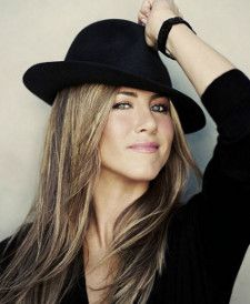 Blonde American actress Jennifer Aniston poses in black with hat