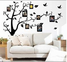 Love this!!! It's a sticker of a tree with birds and you just add the photos!!