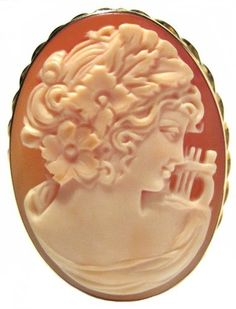 Cameo Pin Pendant Goddess of Music Calliope Carnelian Conch Shell Master Carved, Sterling Silver18k Yellow Gold Overlay Italian cameosRus. $249.00. Italian, Imported, Exceptional Value, Old World Treasure, Rare Find,. 925 Sterling Silver, 18K Yellow Gold Overlay Frame, Museum Quality, One of a Kind,. Exceptional Value, Great Gift, Heirloom Jewelry,. Artisan Jewelry, 1.50 x 1.18 Inches, Entirely Hand Made,. Goddess of Music Calliope, Cameo, Pin Pendant, Carnelian...