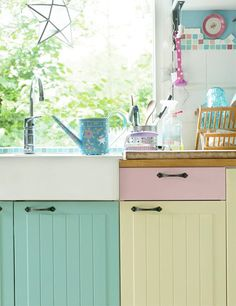 candy coloured painted cabinets in the kitchen