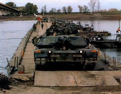 MM1A1 Abrams tanks of the 1st Battalion, 77th Armor, 1st Infantry Division, cross the Savo River into Bosnia, October 20, 1996. They secured the withdrawal of the 1st Armored Division up to the end of the IFOR mandate on December 20. IFOR, the NATO implementation forces, had enforced the terms of the Dayton Peace Accord since 1995.