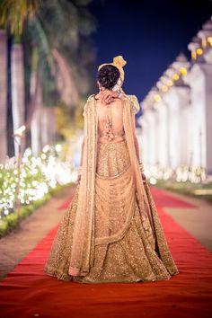 Sangeet Lehengas - Gold Sequin Lehenga | WedMeGood | Gold Full Sequinned Lehenga with Pink Detailing and Double Net Dupatta #wedmegood #indianwedding #indianbride #gold #sequins #pom-poms #lehenga #dupatta #doubledupatta