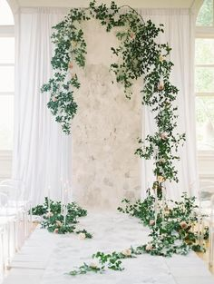 wedding ceremony backdrop made of a printed fabric and smilax