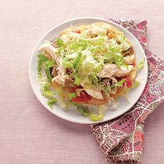 """""""I grew up on King Ranch casserole -- a hearty mix of chicken, tortillas, and spicy tomatoes in a creamy sauce. This version of the Texas classic has the same flavors but is much lighter."""" -- Heather Meldrom, Food Editor"""