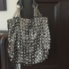 Silver Purse Bling bling! Gorgeous boutique purchase. The bag zips and had two other zip compartments (one on outside of bag and one on inside). I carried a few times and received many compliments! Bags