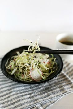 Sweet and Tangy Korean Cabbage Salad - Cabbage and pink radishes served with sweet and tangy roasted sesame seed dressing. It's light, refreshing and crunchy!   MyKoreanKitchen.com #koreanfood #salad #cabbage