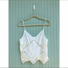 Urban outfitters white lace tank Pins and needles white lace edged tank top. It's a little cropped but not really because the lace goes down far. It's little too small on me but it's a great summer top with buttons up the back. Urban Outfitters Tops Tank Tops