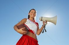 http://images.stockunlimited.net/preview1300/cheerleader-holding-football-and-megaphone-low-angle-view-portrait-portrait--low-angle-view_1878651.jpg