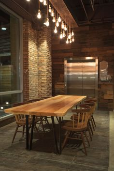Live edge Texas pecan slab and raw steel legs coffee bar community dining table. Fabricated by Vintage Supply. #furnituredesign #bardesign #restaurantdesign #grocerydesign